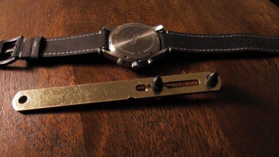 steel watch case opener with audi watch