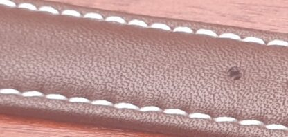 closeup of leather watch strap showing grain